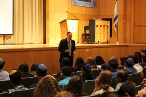 Ari Schonbrun speaking at Kushner high school